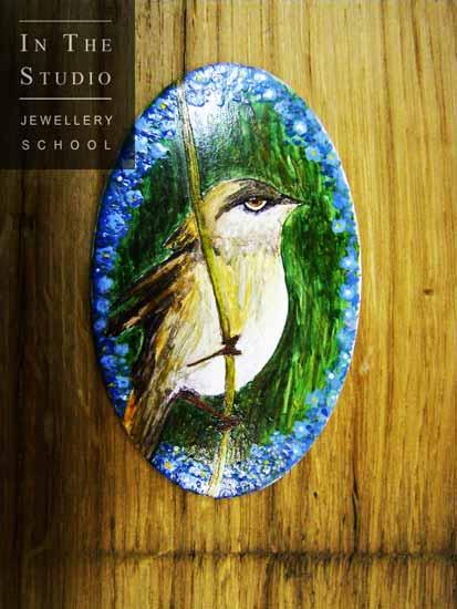 Bird-on-branch-enamel-brooch